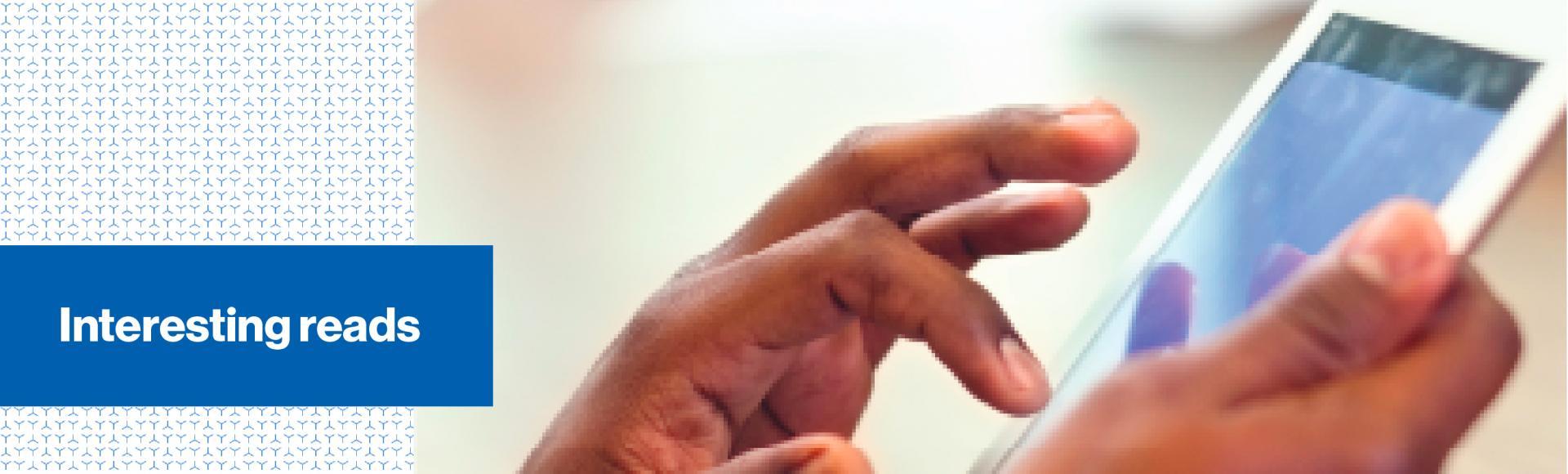 Man's hand touching an iPad screen