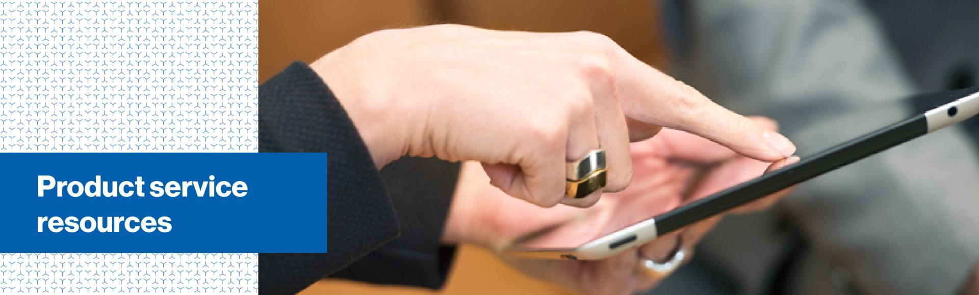 Image of womens hand touching an iPad screen